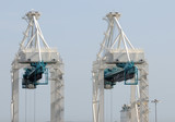 Heavy lifting equipment and cranes at industrial port poster