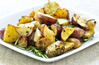 Herb roasted potatoes served on a plate