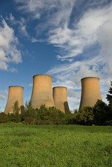 The cooling towers of a power station against a blue sky