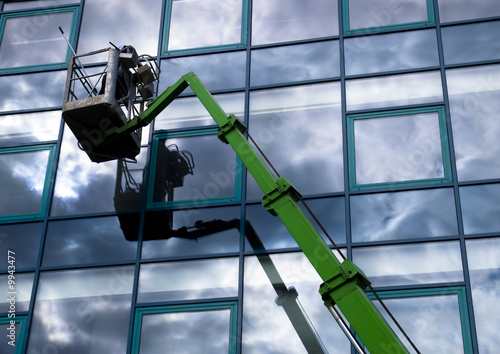 poster of Window cleaner working on a glass facade in a gondola