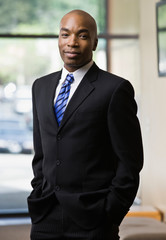 Confident African businessman posing in full suit