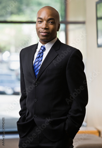 Confident African businessman posing in full suit