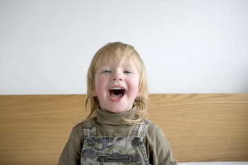 2 and half year old boy playing and smiling