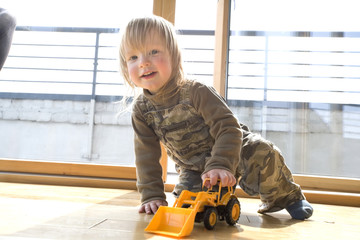 2 and half year old boy playing with a digger