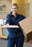 Delivery woman in uniform presenting shipping receipt
