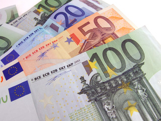 euro bills over white background