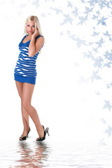 Beautiful young blonde in blue stocking dress