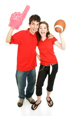 Teen couple roots for their football team.  Full body isolated
