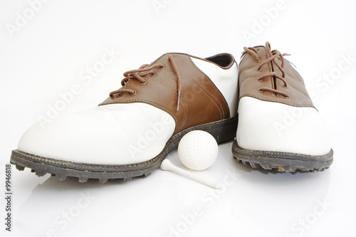 golf shoes ball and tee isolated against white background