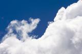 White Cumulus Clouds off the coast of Kauai, Hawaii poster