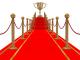 Gold cup of the winner on a red carpet path. poster