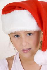 smiling little girl wearing christmas hat