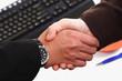 business men shakin hands