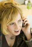 Concerned Young Blonde Caucasian Woman on Mobile Phone poster