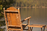 Tranquil Morning Lake Scene with Chair and Table poster