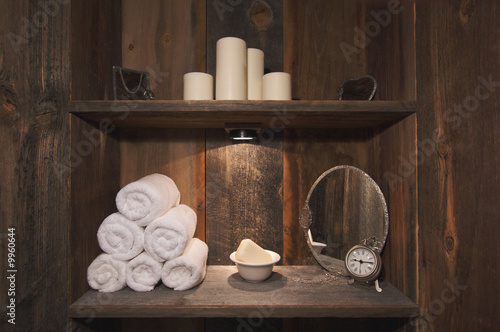 Rustic Spa Scene with Towels, Soap, Mirrors, Candles and Clock. - 9960644