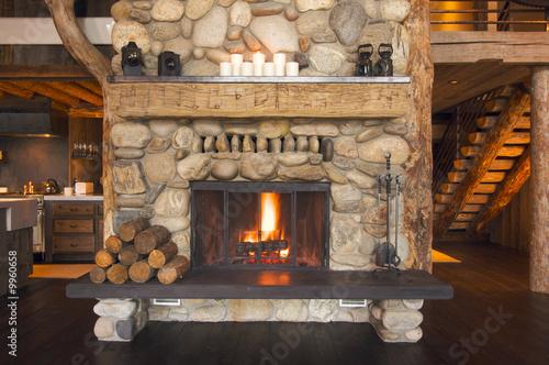 Leinwanddruck Bild Rustic Fireplace in Log Cabin