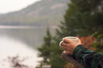 Woman Enjoys Morning Cup Coffee on the Lake.