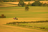 Autumn patchwork farmland with tractor poster