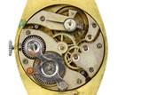 Antique golden wristwatch mechanism on white background poster
