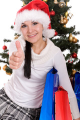 happy brunette woman over christmas tree