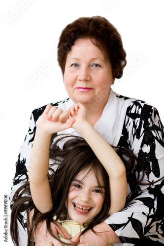 Grandma embraces grandchild smiling playful childhood senior