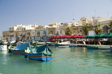 marsaxlokk malta ancient architecture and luzzu fishing boats