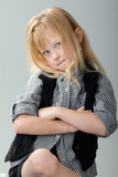 cute blond girl refuses to cooperate - humorous concept