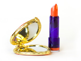 heart shaped pocket mirror and red lipstick