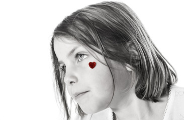 Cute Little Girl with Red Heart on Cheek