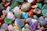 natural background pile of semi precious jewelery stones closeup