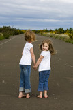 Barefoot kids walking down the road holding hands poster