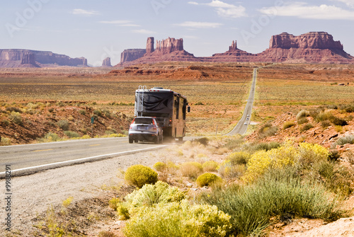 Recreational vehicle driving through Monument Valley - 9988291