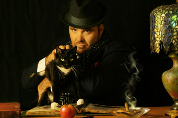 sinister man sitting at a table with a black cat