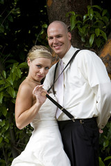 just married wedding couple snapping suspenders with a smile