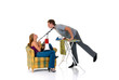 Young bossy woman with megaphone man ironing clothing