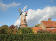 English Village Windmill against a Blue Sky