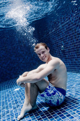 An underwater shot of a man in a swimming pool