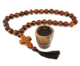 Wood rosary and ancient glass isolated on a white background
