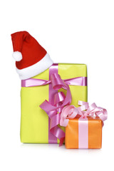 Gift boxes with christmas hat, shadow on background. Shallow DOF