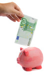Saving a note of one hundred euros in a piggy-bank isolated poster