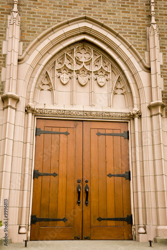 An old wooden church door with iron hinges and handles