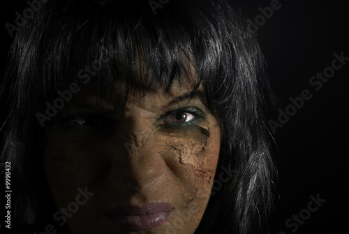 Close-up portrait of the witch with damaged skin