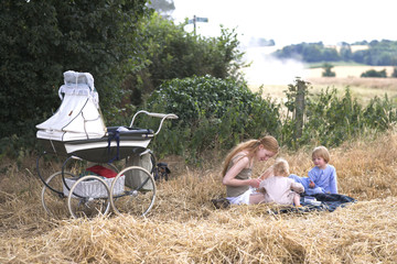 young family having a picknick