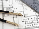 dividers and ruler laying on architectural plan poster