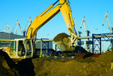 Hydraulic excavator at work Shovel bucket and cranes against sky poster