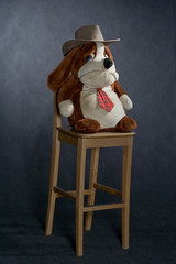 wooden lacquered chair and toy with western hat.