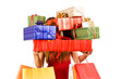 Attractive woman holding many gift boxes and bags