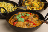 Lamb korma with pilau rice and vegetable curry
