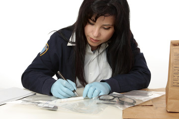 Police detective documents evidence collected  crime scene.